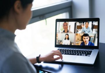 asian female having conference call on laptop